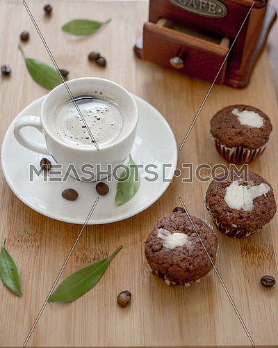 Coffee  and three muffins on wooden table.Selective focus
