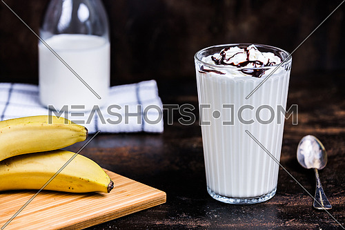 Banana Milk drink with whipped cream and chocolate syrup
