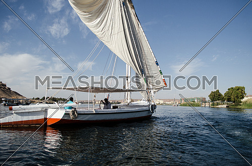 Traditional boat in the river - Aswan