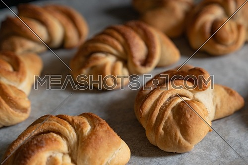 desserts, homemade croissants just pulled out of the oven still on parchment paper