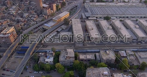 Aerial shot for the city while Metro Passing by in Cairo at sunset