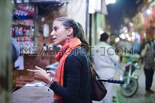 portrait of a young middle eastern woman to enjoy the Souvenir Market