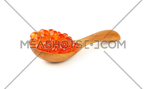 Close up wooden scoop spoon of salmon fish red caviar isolated on white background, low angle view
