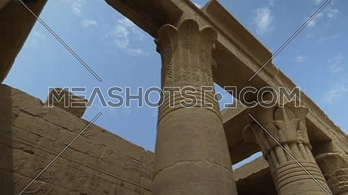 Low angel tracking shot inside Temple of Phila showing columns, Aswan Egypt