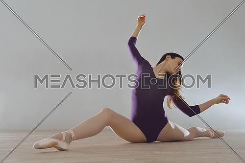 modern style ballet dancer posing and jumping on training