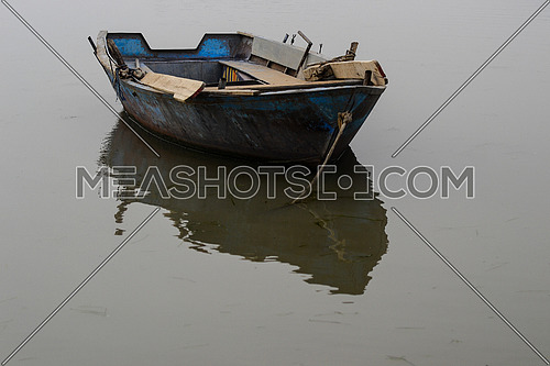 an abandoned boat in the river Nile