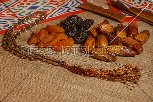 Dates and Ramadan Decorations on a wooden table top