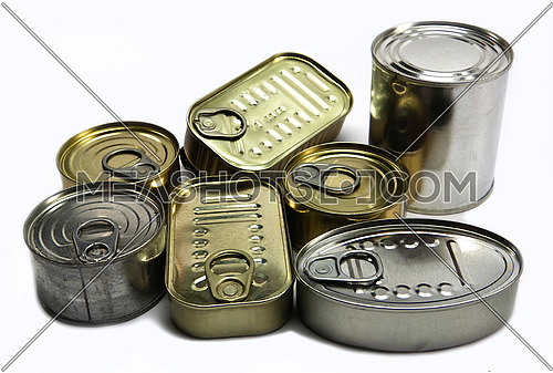 Tins of different sizes and closed, conceptual image