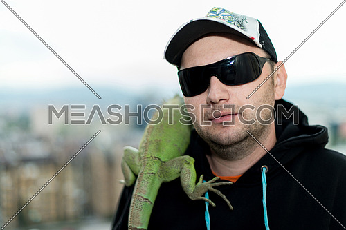 portrait of the young man with the iguana