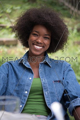 Portrait of Beautiful happy African-American girl sitting outside