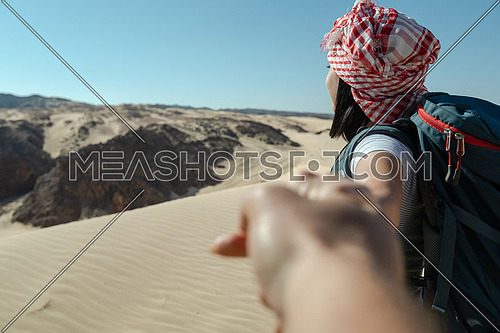 Follow me shot with female tourist from Ain Hodouda at day