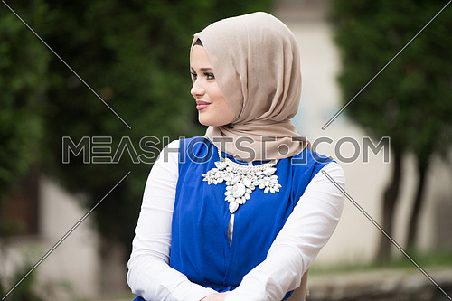 Portrait Of Young Muslim Woman Wearing Scarf While Thinking Outdoor