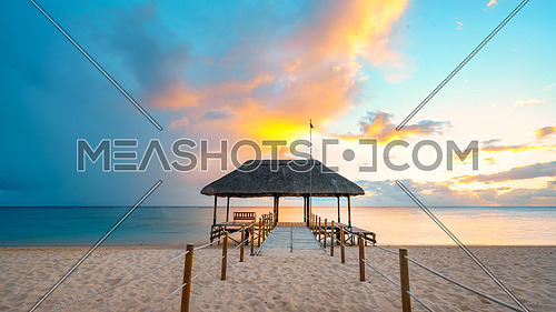 Amazing sunset in Mauritius Island (flic an flac beach) with Jetty silhouette.