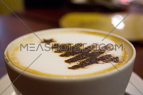 cappuccino with christmas tree powder