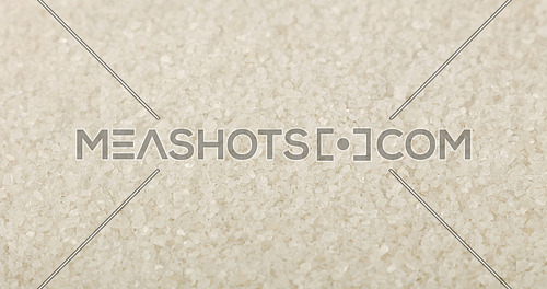 Close up background texture of white sea salt, high angle view, selective focus