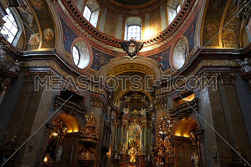 Low angle view of beautiful altar and cupola with fresco of historic baroque church of Saintt Peter in Vienna, Austria