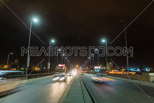 Long shot for traffic on Suez Canal Bridge at Alexandria at night
