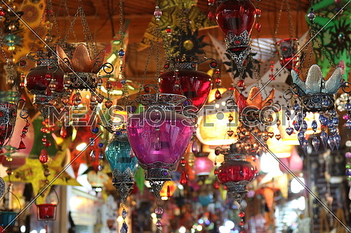 A group of oriental Arabic lanterns hanging from ceiling