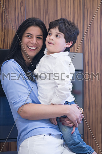 middle east mother and son spend quality time in the kitchen and enjoy it
