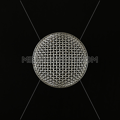 Microphone top view over black background, close up, personal perspective