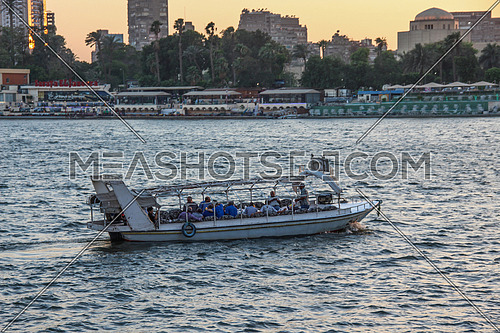 a photo from Cairo, Egypt showing the river Nile and boat carrying people