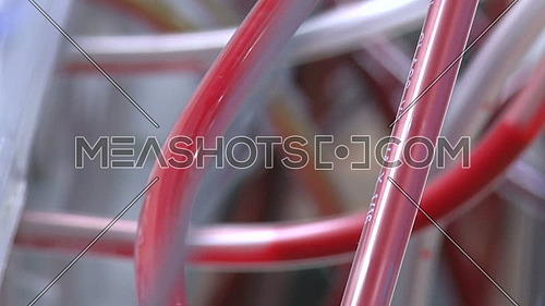 Close up for blood pumping through tubes of heart-lung bypass machine