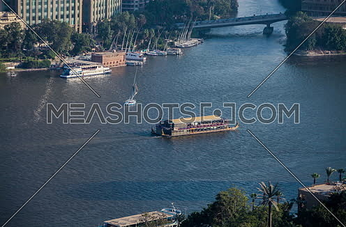 Fixed Top Shot for Pharaoh Boat sailing in River Nile at Day
