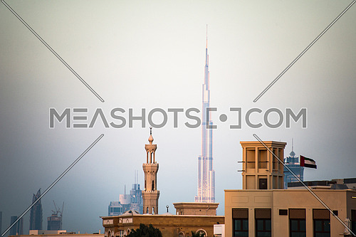 Dubai skyline with a minirate and burj khalifa in the background