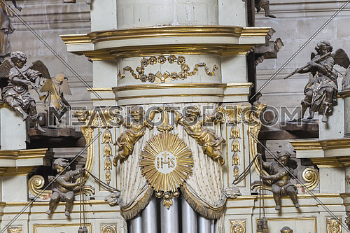 Jaen, Spain - may 2016, 2: Detail of the top turret of the box of the organ with the musical angels, is on the choir in the side of the Epistle of the Cathedral,take in Jaen, Spain