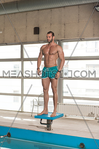 Portrait Of A Very Muscular Sexy Man In Underwear At Swimming Pool
