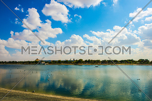 Blue sky and clouds reflected on a lake