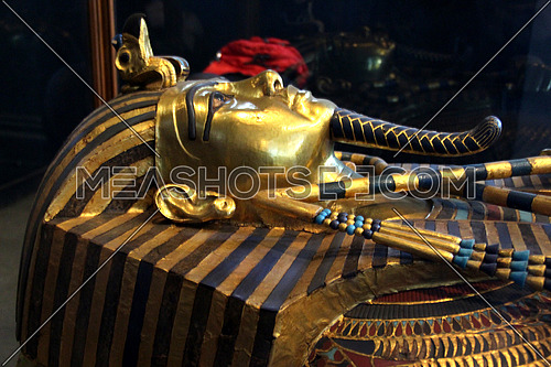 a photo from inside the Egyptian museum showing the  face and statue of king TUTANKHAMEN ancient Egyptian pharaoh