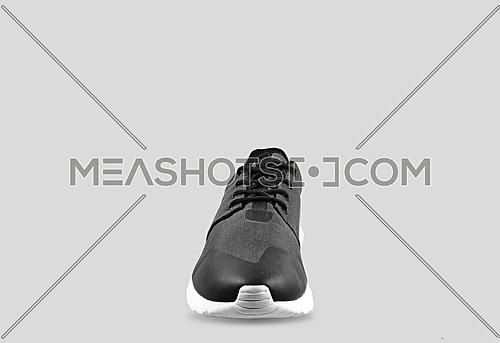 black and silver shoes on grey background