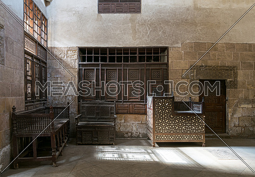 Room at El Sehemy house, old Ottoman house in Cairo, built in 1648, with interleaved wooden windows (Mashrabiya) and arabisk wooden couches