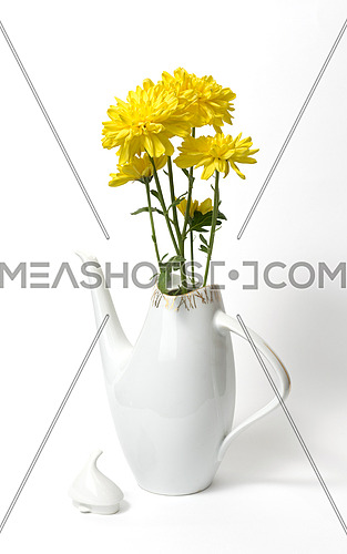 Czech ceramic white teapot with yellow flowers on white background, dating back to the 1960s