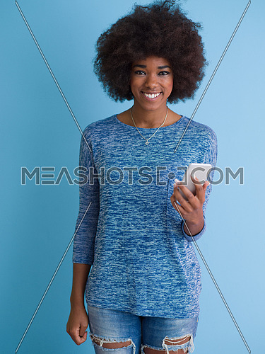 Young Happy African American Woman Using mobile phone  Isolated on a blue background