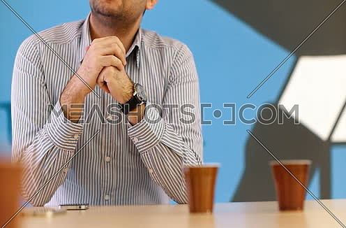Business man using hands to explain business idea at strtup office