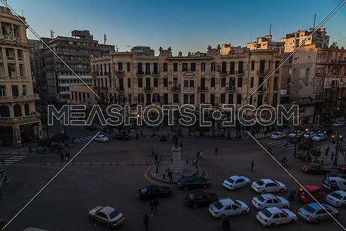 Long Shot for Traffic at Talat Harb Street at Cairo from Day to night