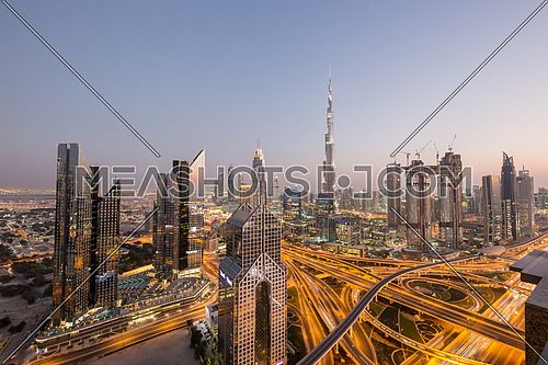 Extreme long shot for Dubai City showing Burj Khalifa and skyscrapers and traffic at day