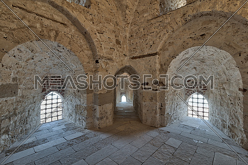 Three arches leading to windows on brick stone wall of a passage surrounding the Citadel of Qaitbay, Alexandria, Egypt