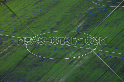 Background of green grass soccer football field center with markings, high angle view