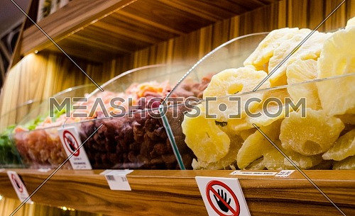 Pineapple and raspberry dry fruit and spices display in a shop in the Spice market with a variety of colors and delicious dry fruit are on display