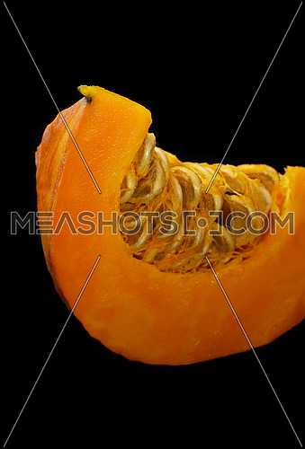 fresh deep vivid yellow pumkin  on black background