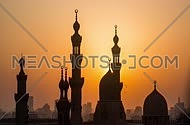 A sunset timelapse of Islamic Cairo showing the sun setting off behind mosque minarets