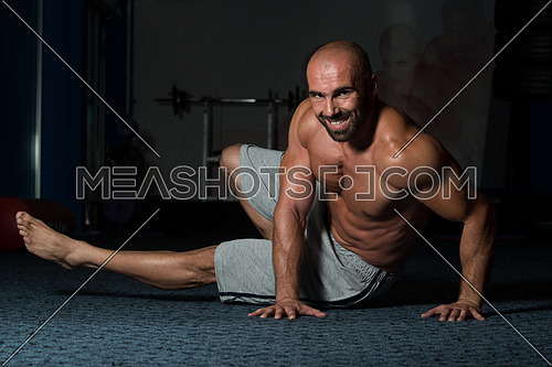 Healthy Adult Man Exercising Abdominals On Foor