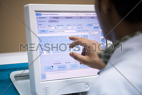 young middle eastern man works in front of the monitor in modern laboratories
