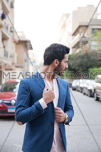 A young business man walking in the street