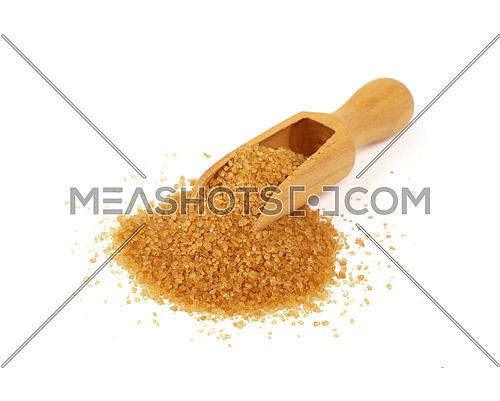 Close up one wooden scoop spoon full of raw brown cane sugar with pinch spilled and spread around, isolated on white background, high angle view