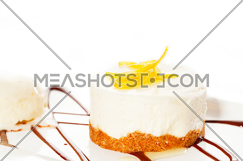 very elegant lemon mousse dessert served whith lemon peel on top and vanilla ice cream on side, MORE DELICIOUS FOOD ON PORTFOLIO