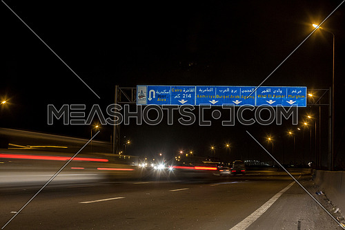 Long shot for Cars moving at Cairo-Alexandria Desert Road at Night